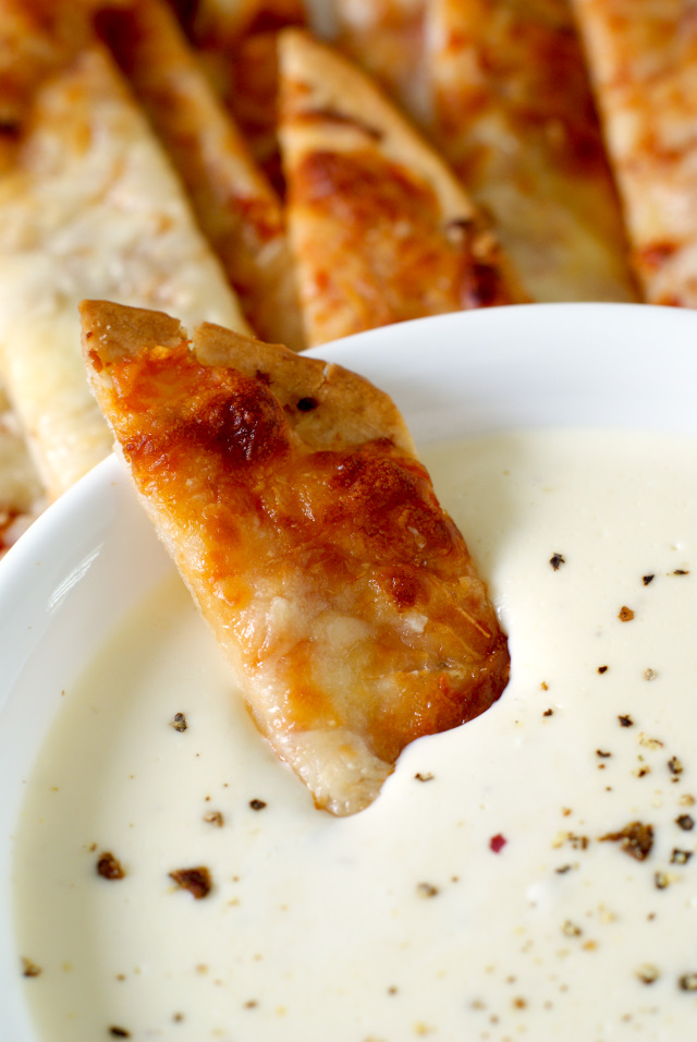 Pizza Sticks with Three Cheese Alfredo Dip | thetwobiteclub.com