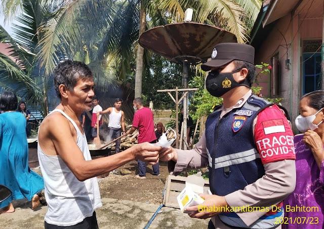 Polsek Murung Sosialisasikan Prokes Dan Bagikan Masker Ke Warga Desa Bahitom