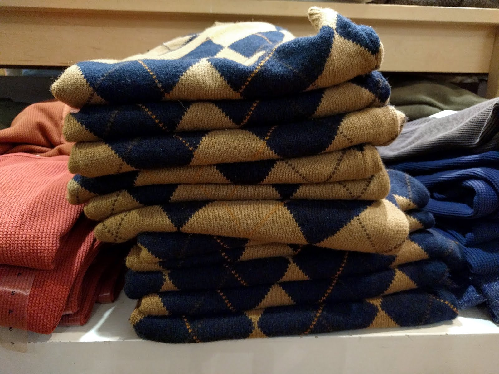 United Arrows camel and navy wool argyle sweater vests piled up on Black  Friday at the Metrotown GAP. One of my favourite pieces 5faf045ac101