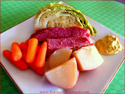 Crockpot Beer-Infused NE Boiled Dinner, for St. Patrick's Day or any day. Brown sugar rubbed corned beef, baby carrots, new potatoes and cabbage slow cooked in beer. | Recipe developed by www.BakingInATornado.com | #dinner #Crockpot #StPatricksDay