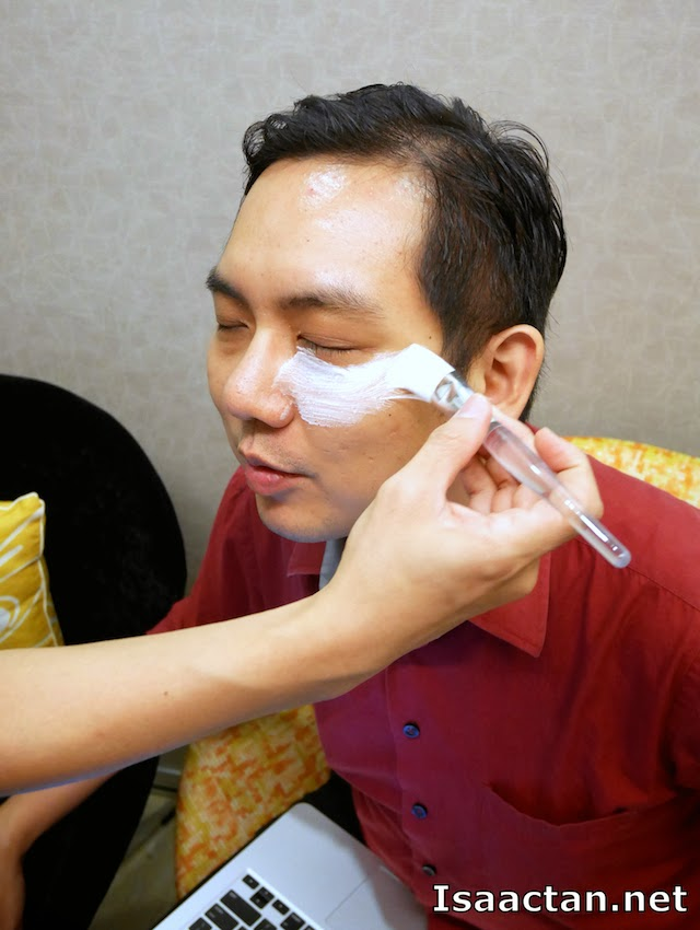 Applying the numbing cream to prepare me for the DermaFiller procedure