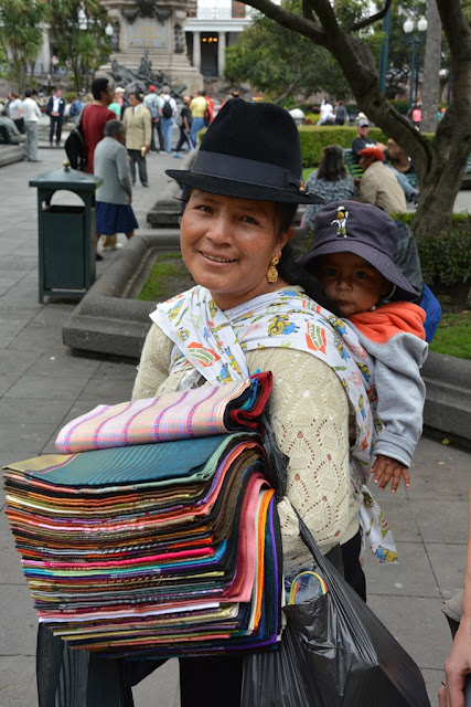 Main Square Quito lady selling scarfs