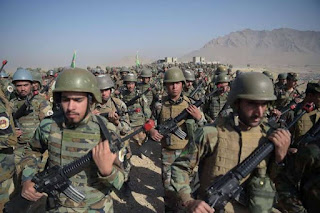 Afghan National Army soldiers march during a military exercise at the Kabul Military Training Center