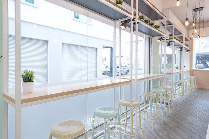 icebing dessert cafe malacca bar height seating area with white metal structure and wood table top