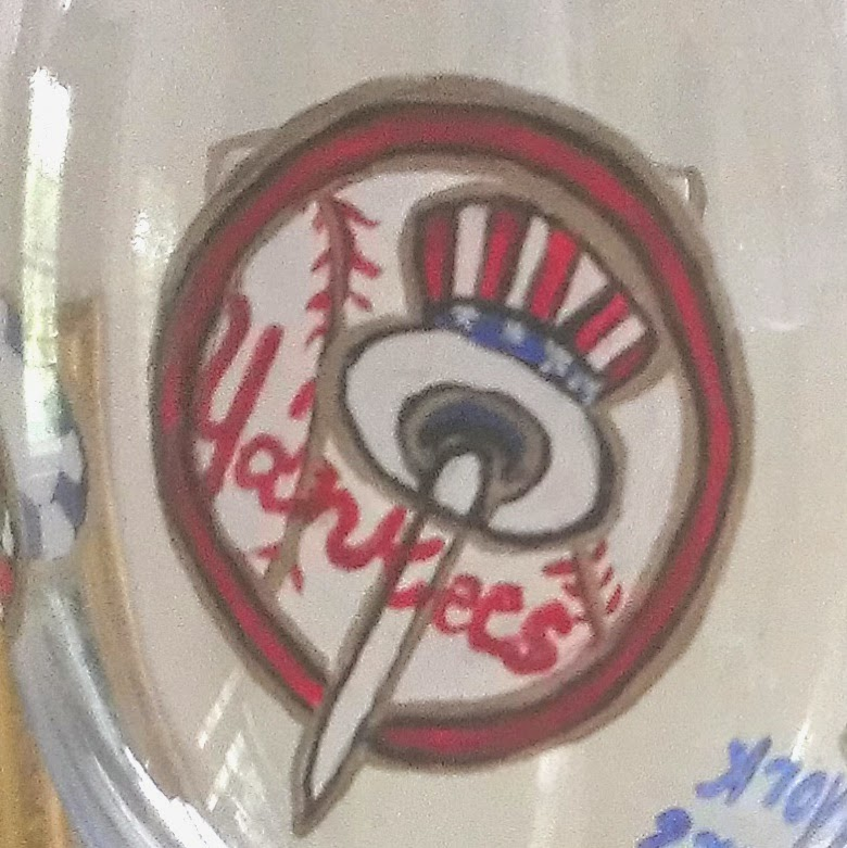 Yankees logo hand painted on beer glass