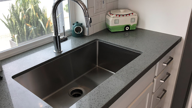 How to unclog a double sink with standing water