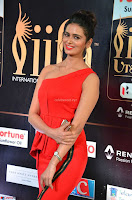 Meenakshi Dixit in Red One Shoulder Red Zipped up gown at IIFA Utsavam Awards003.JPG