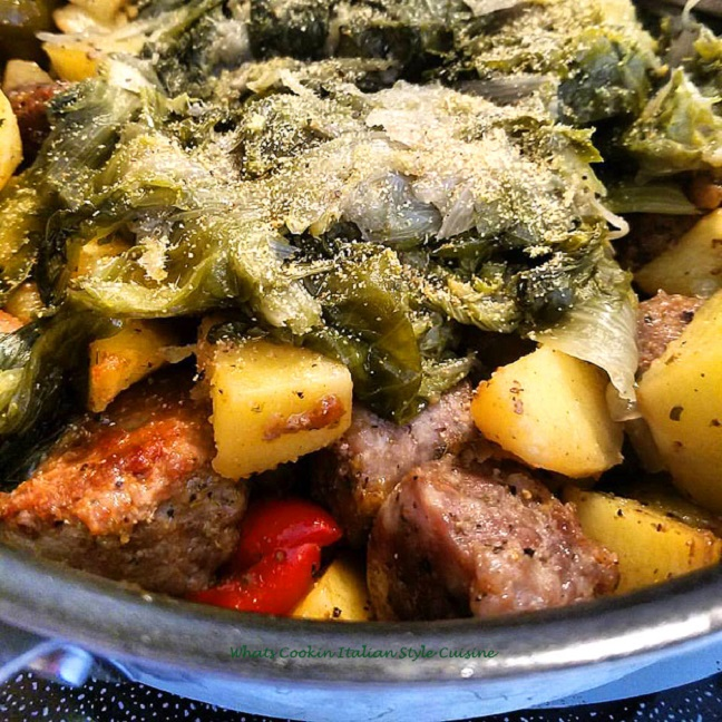 this is utica greens from central new york with potatoes sausage ham peppers escarole cheese and bread crumbs on top