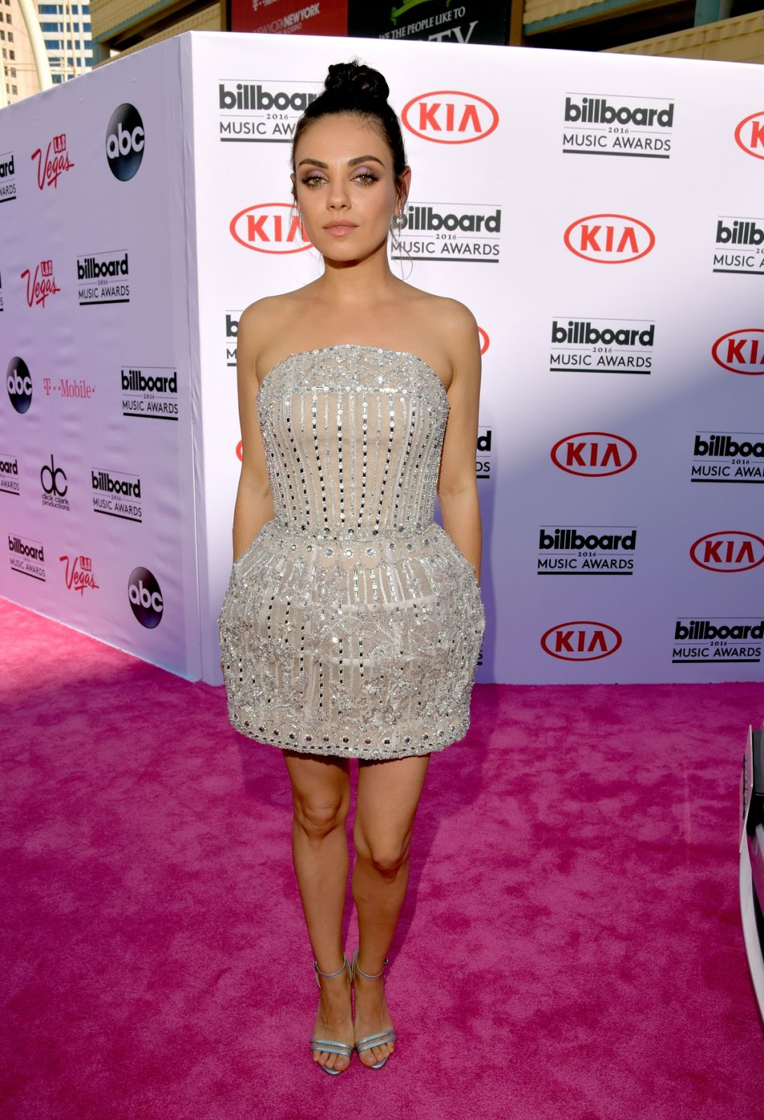 Mila Kunis is chic in a strapless silver dress at the Billboard Music Awards 2016
