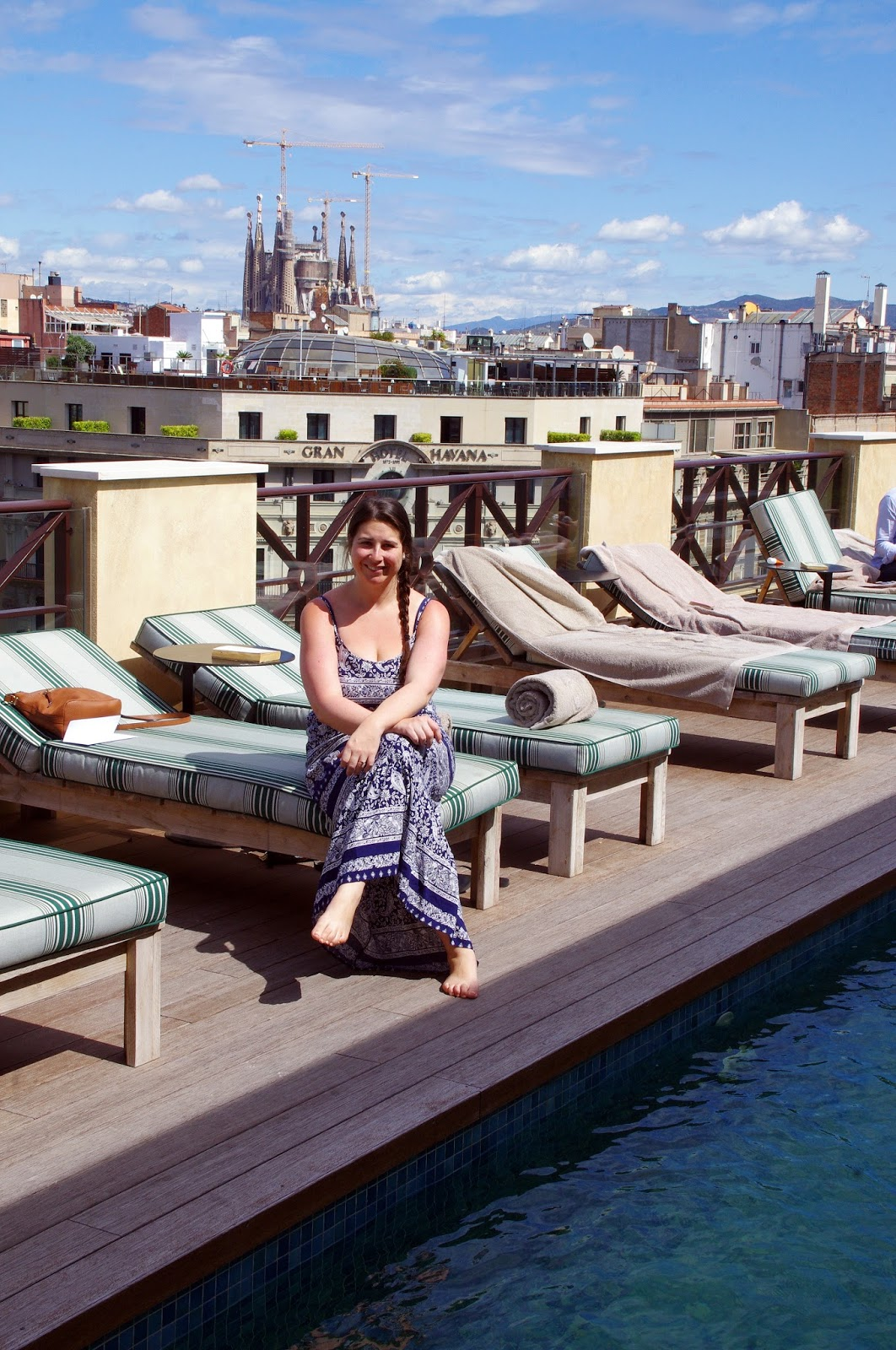Simone on rooftop overlooking Sagrada from Cotton House Hotel Barcelona