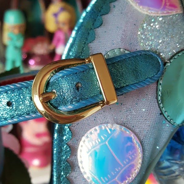 close up of large buckle on strap of shoe