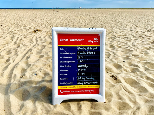 A sign put up by the Lifeguards on Great Yarmouth beach showing information about the day, weather and tide