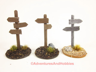 Group of three wooden roadside sign posts for 25-28mm scale miniature wargaming.