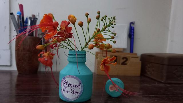 Old ink pot as a flower vase