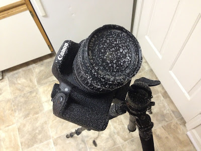 canon camera covered in frost