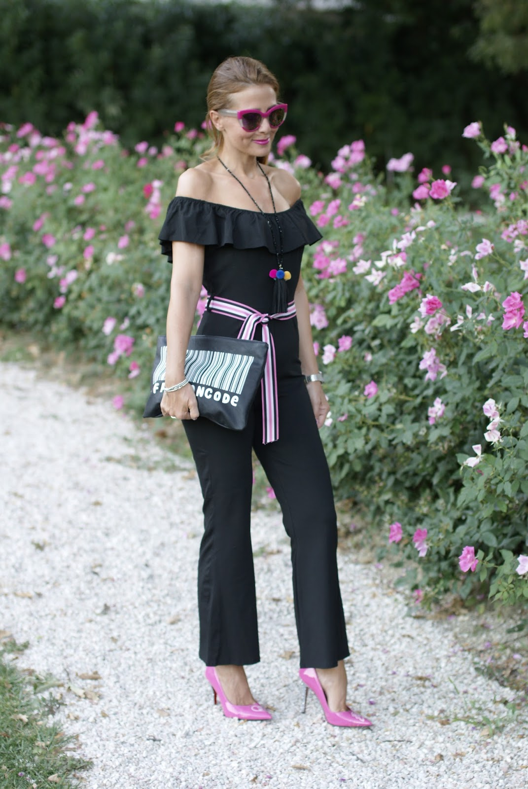 Black off the shoulder jumpsuit on Fashion and Cookies fashion blog, fashion blogger style