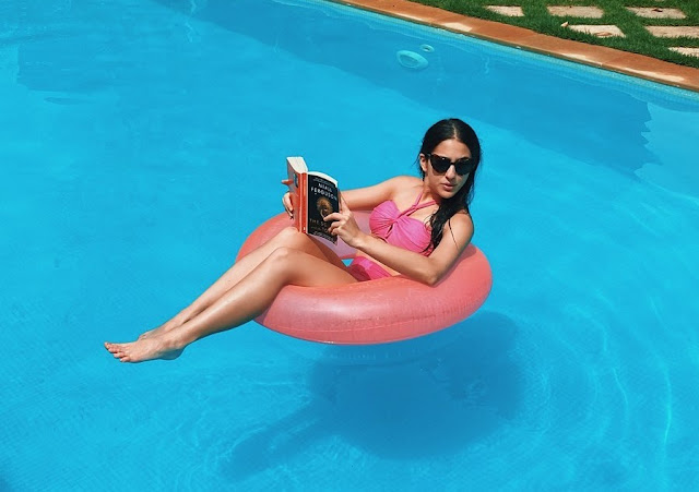 Sara ali khan wearing a pink bikini and chilling on a pink float - newsdezire