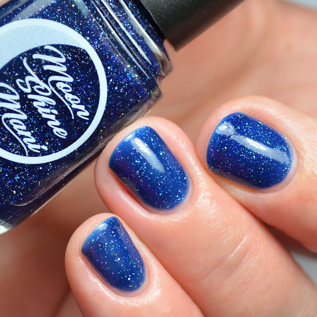 blue nail polish with holographic flecks