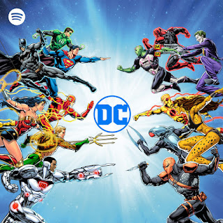 Various DC comic characters like Batman, Superman, Wonderwoman etc around the DC logo with the spotify logo in the corner