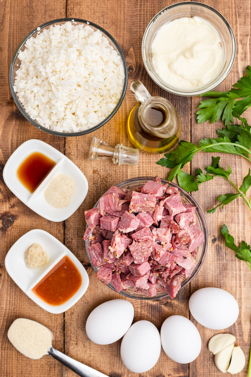 Photo of the ingredients needed to make Keto Corned Beef and Hash on a wooden table.