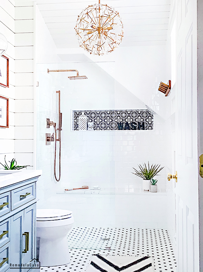 white bathroom with gray vanity, shiplap and subway tile