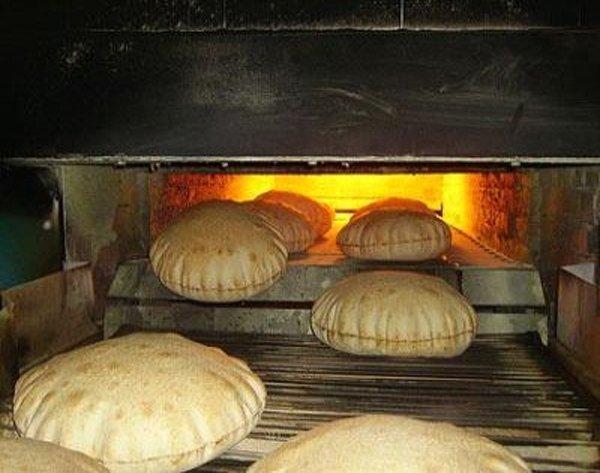 تحضير الخبز بالمخبز الالى