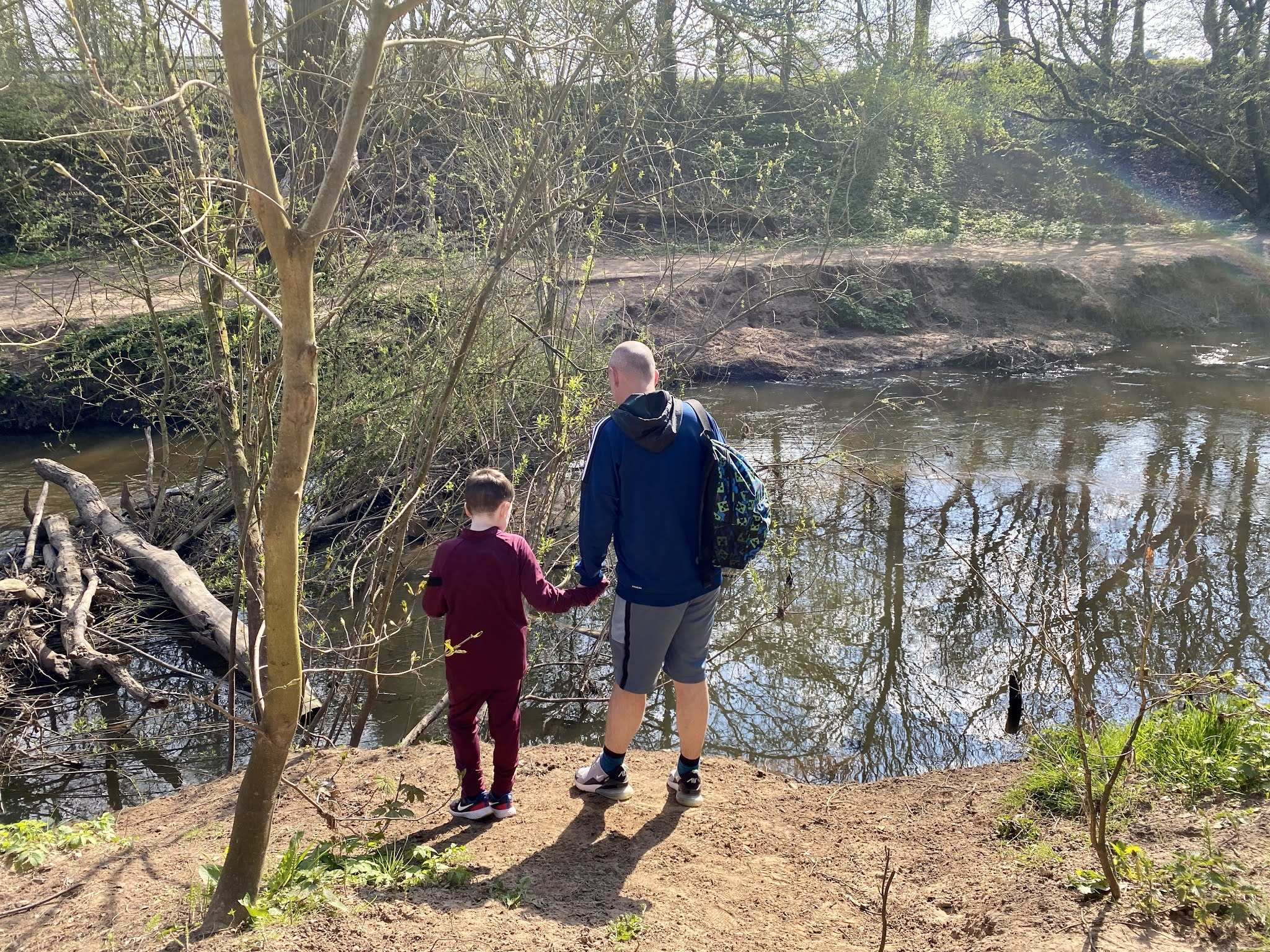 dad and son looking in the river