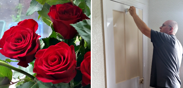 A bunch of roses and my fella painting a door