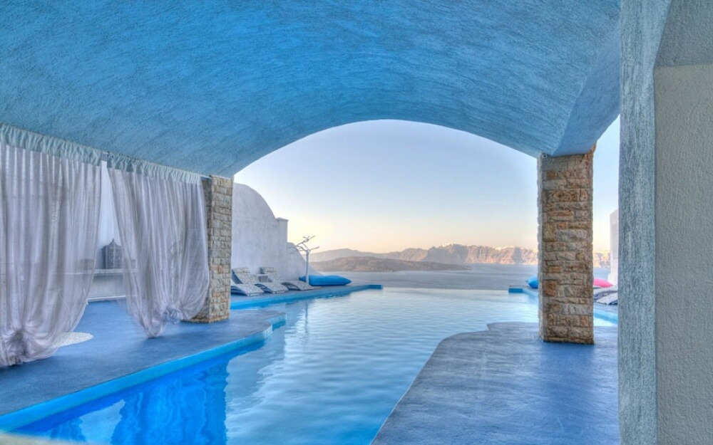 22 Stunning Hotels That Will Make You Want to Book Your Next Trip NOW! - Astarte Suits Hotel, Greece