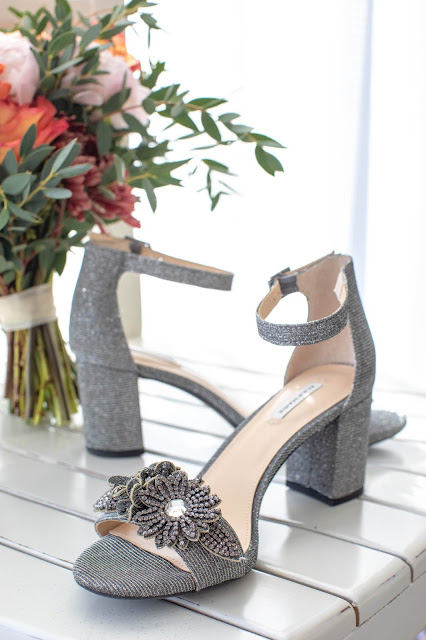 Photographs of bridal shoes and floral bouquet.