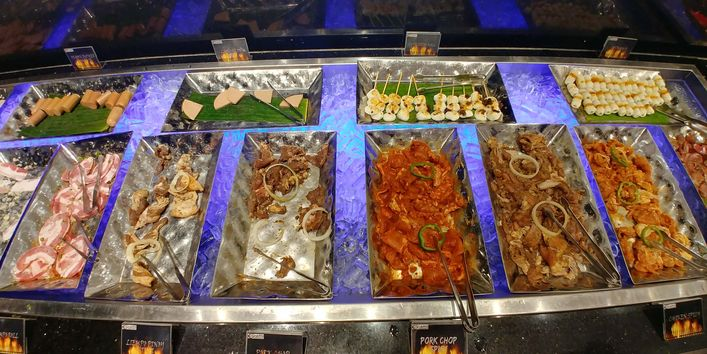 Fresh meat and seafood station at Yakimix