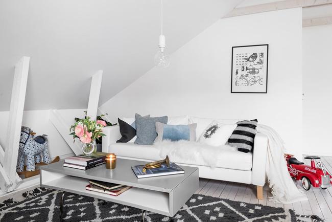 Salón sofá blanco estilo nórdico