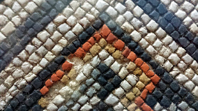 Square geometric patterns of the Louvignies mosaic.