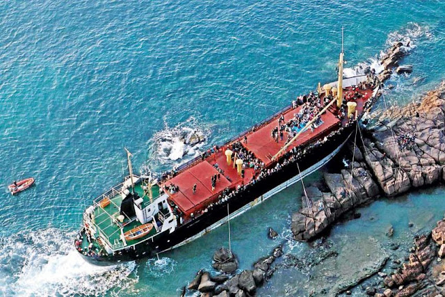 An aerial view of the Cambodian-registered cargo ship East Sea taken in 2001. The crew abandoned the vessel after it beached on the coast of southern France with more than 900 illegal immigrants on board. Afp