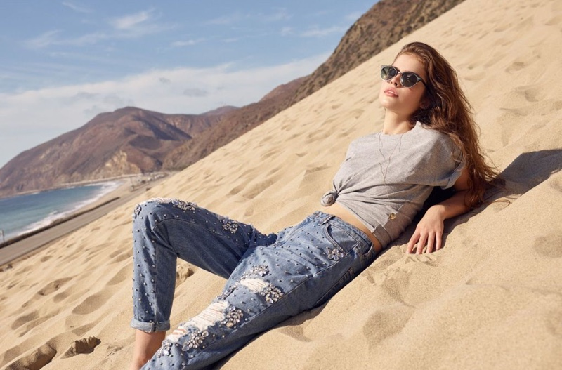 Lily Jean Harvey lounges in Topshop's spring 2017 campaign with sweater and ripped denim