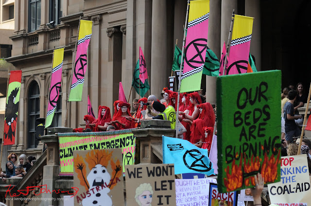Sydney Climate Rally - Red costumed Extinction Rebellion performance during speech.