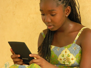 Teen girl in green dress using a tablet