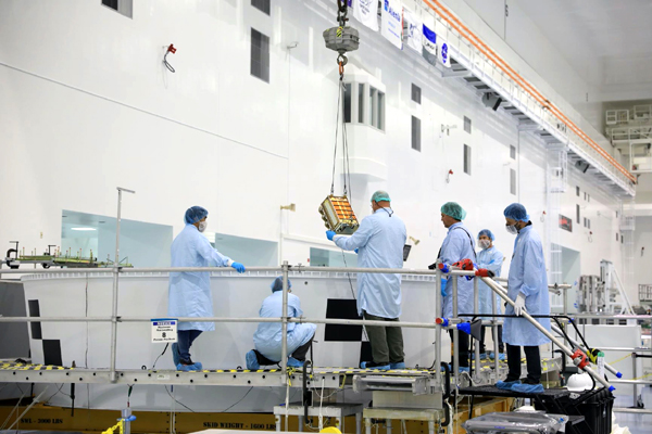 The first of 13 CubeSats is about to be installed inside the Orion Stage Adapter at Kennedy Space Center's Space Station Processing Facility...on July 14, 2021.