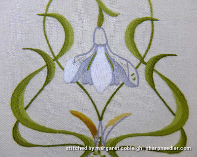 Close-up of central snowdrop flower showing the white sections partially embroidered