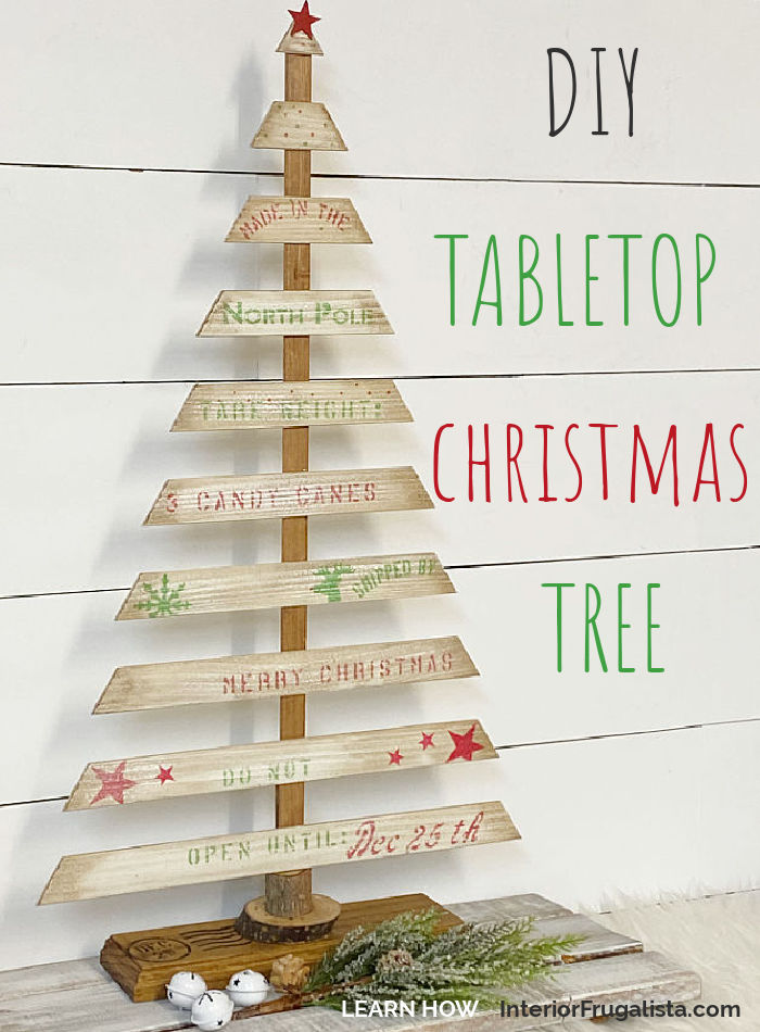 A Rustic DIY Tabletop Christmas Tree with Farmhouse Style by Interior Frugalista made with recycled louvered bifold door wooden slats and a festive crate style stencil. A budget holiday decorating idea for indoors or outdoors.#diychristmastree #woodenchristmascrafts #festivechristmasideas