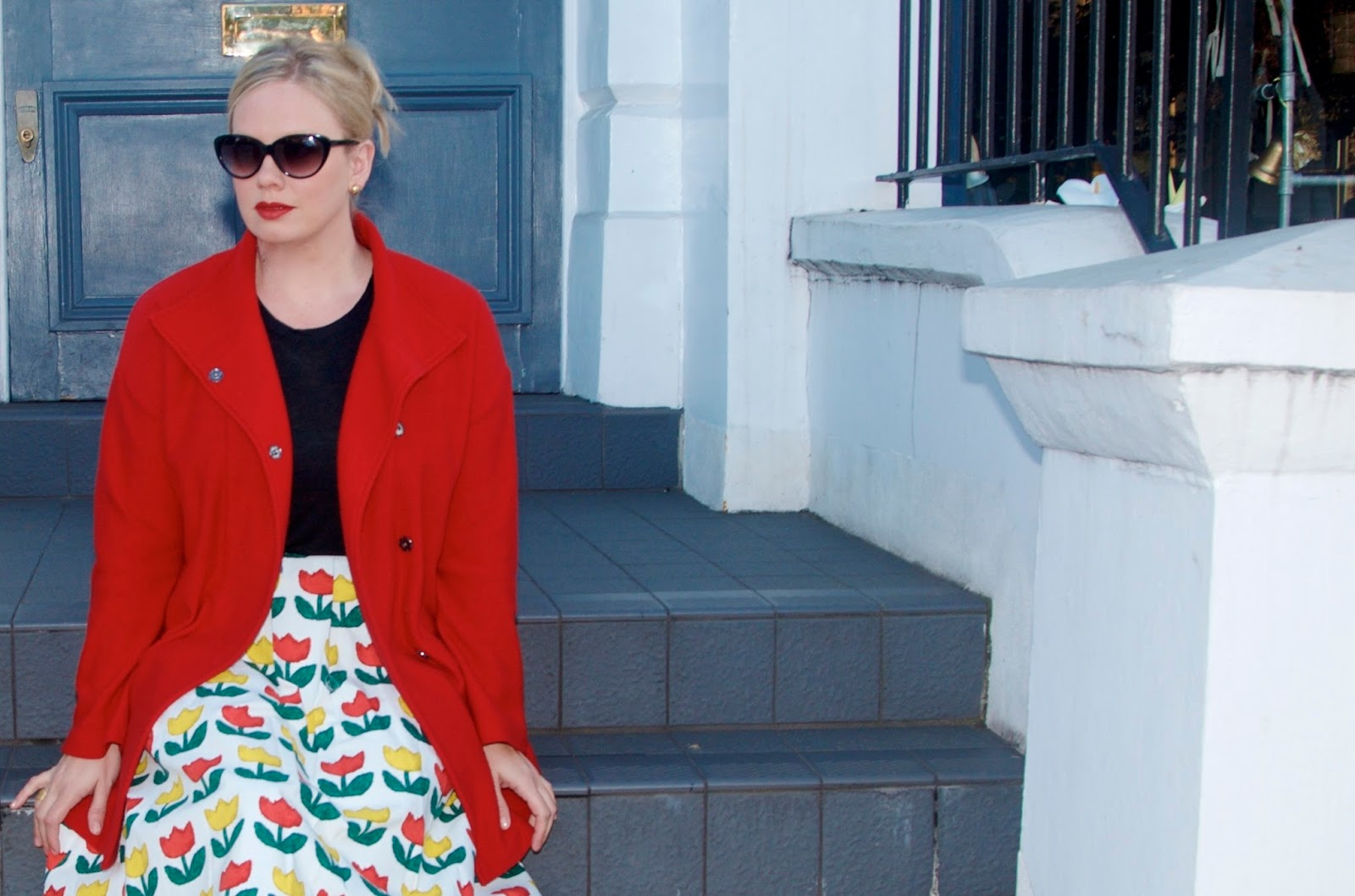 red coat and tulip skirt