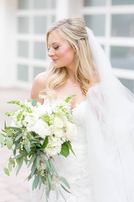 bride with her white bridal bouquet