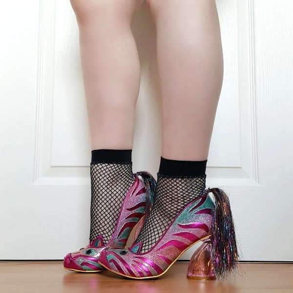 wearing pink and green zebra themed court shoes with colourful tinsel tail at heel