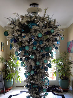 Upside-down Christmas tree decorated in white and shades of blue
