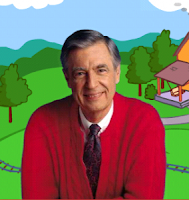 Mr. Rogers lowers the toilet seat