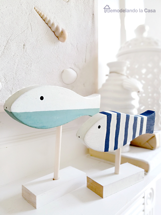 set of wooden fish on mantel