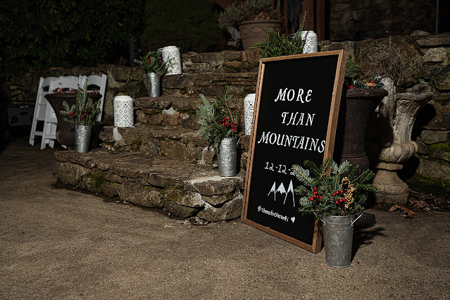 Nighttime detail shot of entrance welcome sign and stone staircase Magnolia Farm Asheville Wedding Photography captured by Houghton Photography