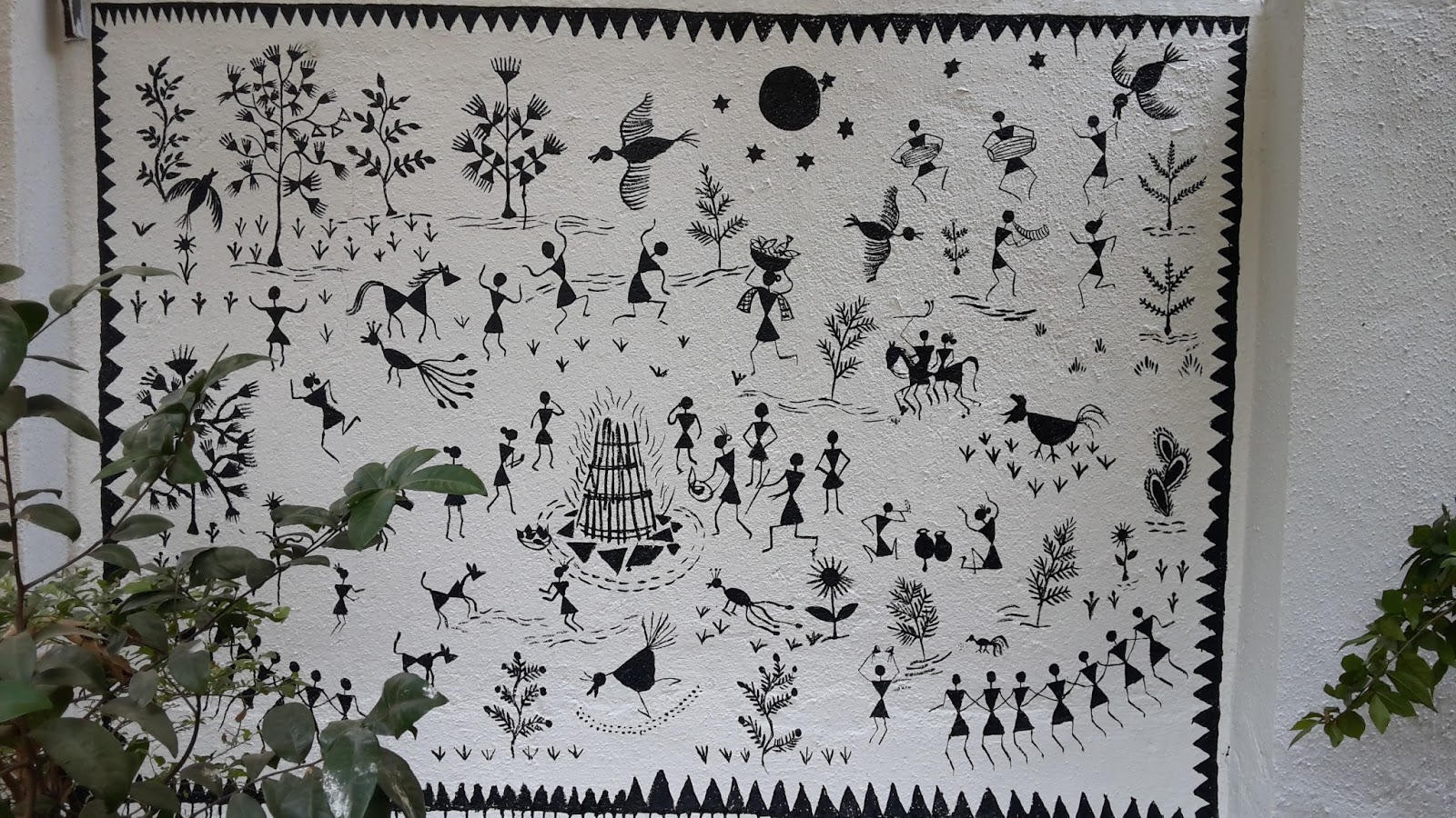 Completed Warli painting on the wall