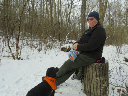 hiker and small dog in winter
