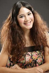 model rambut keriting kucir+atas